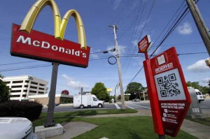 McDonald's promotes the presence of beacons with mobile ads and outdoor signage.