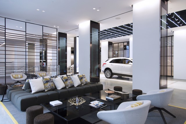 Cadillacs will be stationed on the runway inside Cadillac House. And there's a place to sit and have coffee as well. Source: Cadillac and Gensler